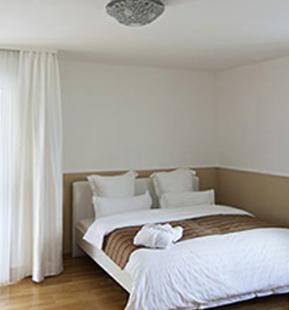 Schlafzimmer des exklusiven BusinessApartment 48Stenger in Goldbach